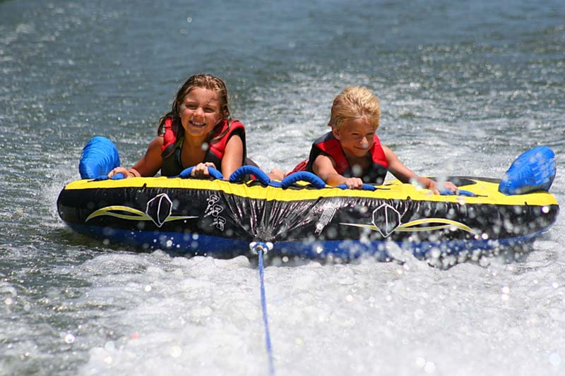 Two girls tubing on Lake George