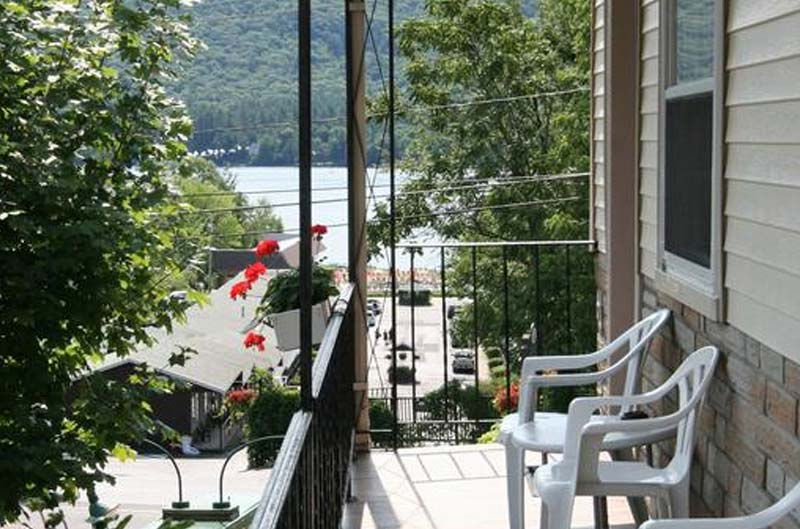 Balcony with chairs and flowers over looking Lake George