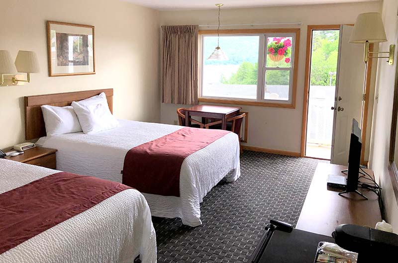 2 queens beds in motel room overlooking lake george